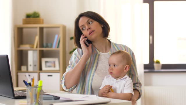 working mother with baby calling on smartphone - spanish and portuguese ethnicity stock videos & royalty-free footage
