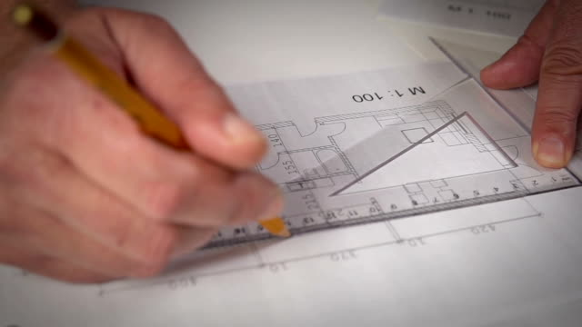 Working on House plans Close up Hand of Architect drawing on Blueprints office illustrations videos stock videos & royalty-free footage