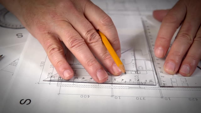 Working on House plans Close up Hand of Architect drawing on Blueprints blueprint stock videos & royalty-free footage