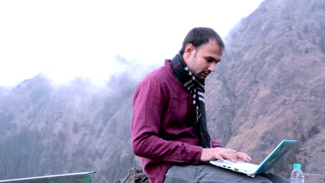 Working on laptop in the nature video