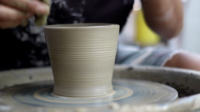 working on pottery wheel video