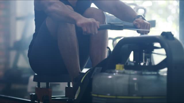 stockvideo's en b-roll-footage met uitwerken is therapie voor het lichaam - fitnessapparaat