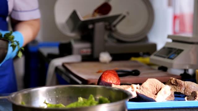 working place in factory of flight catering closeup - mestiere nella ristorazione video stock e b–roll