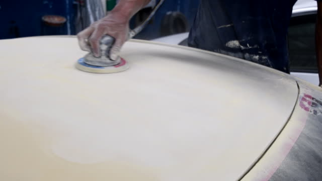 working sanding primer before painting with random orbital sander (air tool) - levigatrice video stock e b–roll