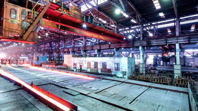 working steel rolling factory interior, time lapse. - metallindustri bildbanksvideor och videomaterial från bakom kulisserna