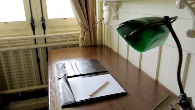 working table with antique table lamp, Dolly shot video