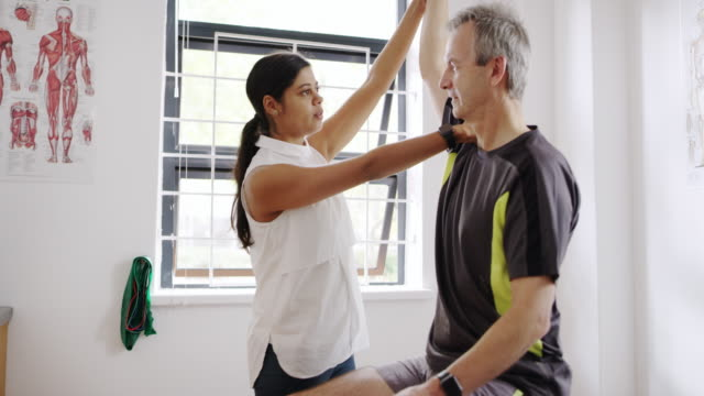 Working together to achieve optimum health 4k footage of a physiotherapist doing arm exercises with her patient shoulder stock videos & royalty-free footage