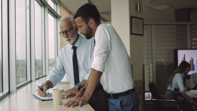 working with experienced manager in the office - dirigente video stock e b–roll