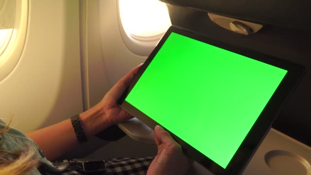working with laptop tablet pc on aircraft,green screen and chroma key.