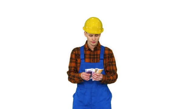 A workman counting cash in exaggerated way and dancing after that on white background