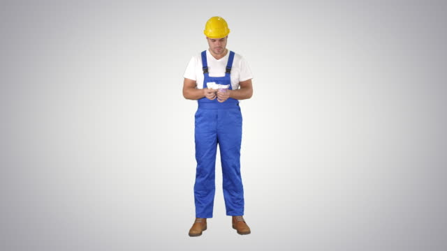 A workman excitedly counting his salary on gradient background