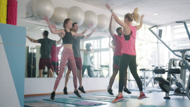 Workout Group Doing Dynamic Stretching at Gym video
