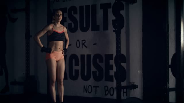Workout in gym Young woman exercising in gym. prop stock videos & royalty-free footage