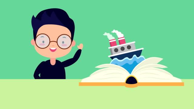 world book day firande med liten pojke och skeppsbåt - digital reading child bildbanksvideor och videomaterial från bakom kulisserna