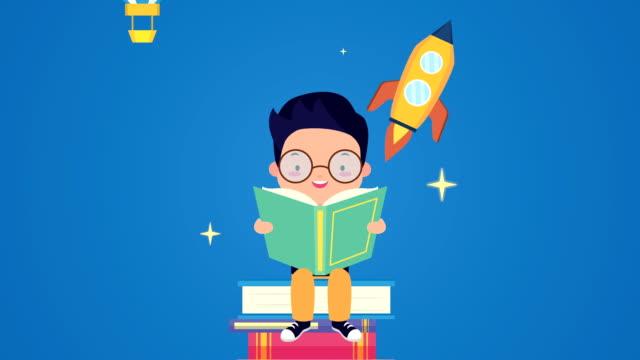world book day firande med liten pojke läsning och raket - digital reading child bildbanksvideor och videomaterial från bakom kulisserna