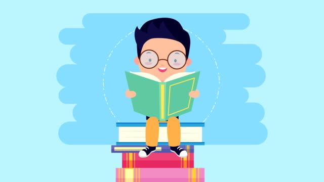 world book day firande med liten pojke läsning - digital reading child bildbanksvideor och videomaterial från bakom kulisserna