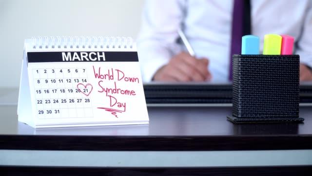 world down syndrome day - speciella dag - calendar workout bildbanksvideor och videomaterial från bakom kulisserna