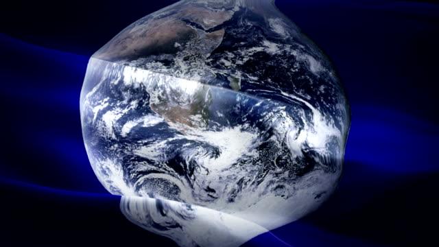 vídeos y material grabado en eventos de stock de día mundial de la tierra ondeando la bandera de fondo vídeo ondeando en el viento. fondo conceptual realista de la vida. tierra desde el espacio flag looping 1080p full hd 1920x1080 material de archivo. la vida en el día de la tierra signo de organizaci - día de la tierra