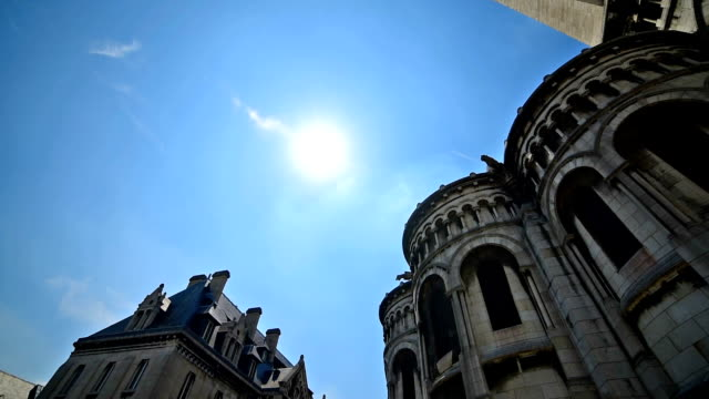World famous Sacre Coeur cathedral under a shining sun. Paris, France