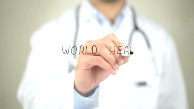World Health Day , Doctor writing on transparent screen World Health Day , Doctor writing on transparent screen world health day stock videos & royalty-free footage