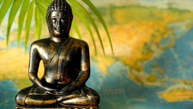 World Map. Journey Explore Concept. Abstract travel Asia background with copy space. World Map. Journey Explore Concept. Abstract travel destination background with copy space. Trip Southeast Asia. Sitting buddha as symbol of asian culture. Close up slill life, soft selective focus. international match stock videos & royalty-free footage