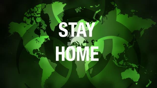vídeos y material grabado en eventos de stock de mapa del mundo con creciente mensaje stay home. - stay home