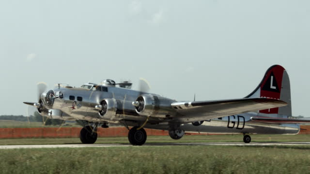 World War II B-17 Flying Fortress taxiing 24P B-17 Flying Fortress, World War II bomber taxis through shot.  Mute. Recorded in 4K, ultra high definition. airfield stock videos & royalty-free footage