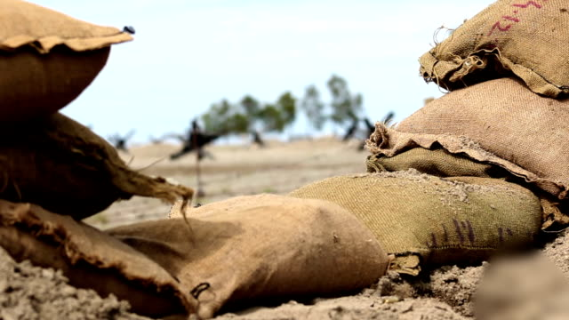 World War Two - Establishing shot of sandbag dugout trench at normandy beach World War Two - Establishing shot of sandbag dugout trench at normandy beach normandy stock videos & royalty-free footage