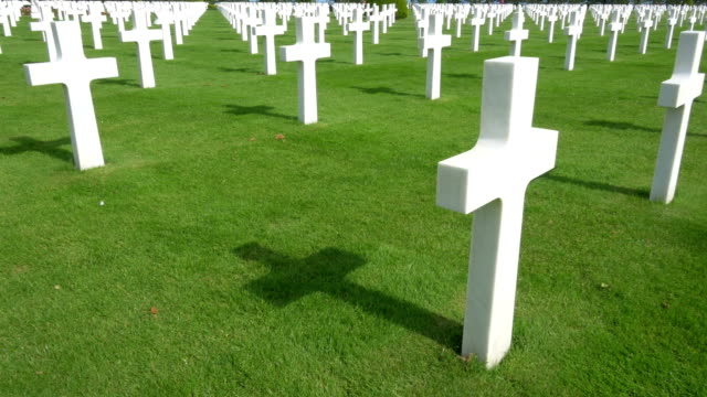 World-war II American cemetery, Colleville-Sur-Mer, France. World-war II American cemetery of 9387 graves in front of the sea-strip where the dramatic battle at Omaha Beach began on the 6th of juin 1944. normandy stock videos & royalty-free footage