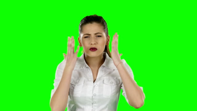 Worried businesswoman holding her head against. Green screen video