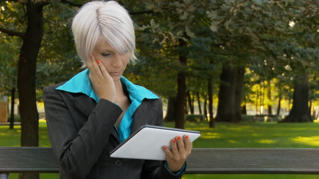 HD DOLLY: Worried Businesswoman Using Digital Tablet video