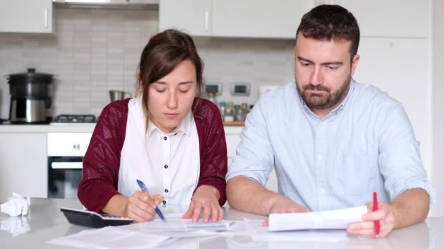 Worried  couple who can not pay their debts video