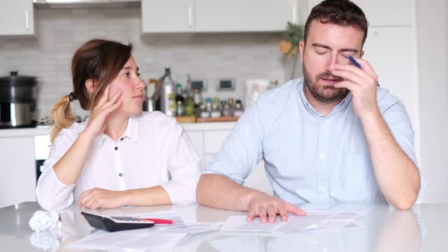 worried couple who can not pay their debts - bills and taxes stock videos & royalty-free footage