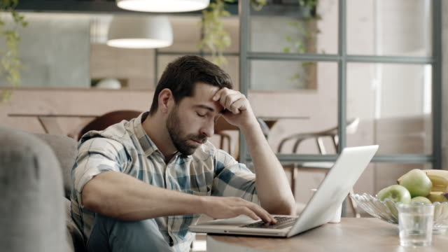Worried man closing laptop