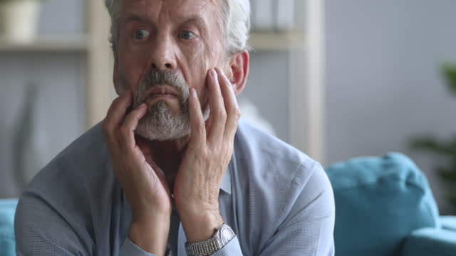 Worried older mature man suffering from depression.