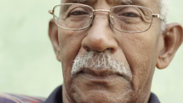 Worried senior african american man with eyeglasses video