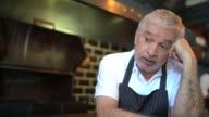 istock Worried senior chef thinking 1255914741