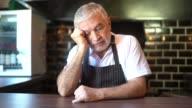 istock Worried senior chef thinking 1255915249