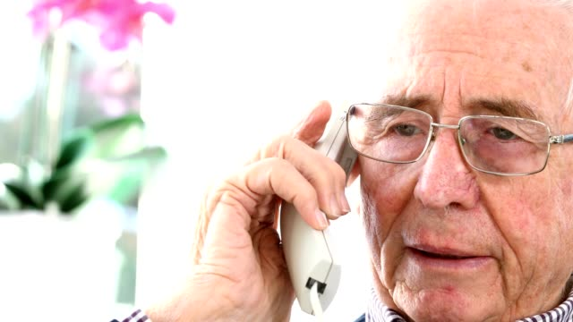 Worried Senior Man Answering Telephone At Home video