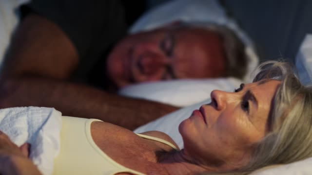 Worried Senior Woman In Bed At Night Suffering With Insomnia Worried Senior Woman In Bed At Night Suffering With Insomnia insomnia stock videos & royalty-free footage