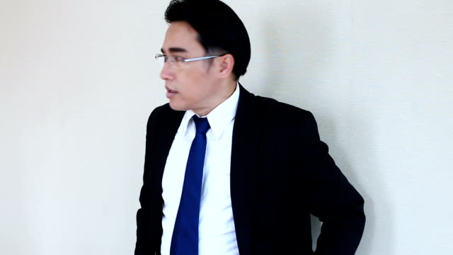 worry asian businessman with glasses and suit is waiting for someone with stressful and worry video