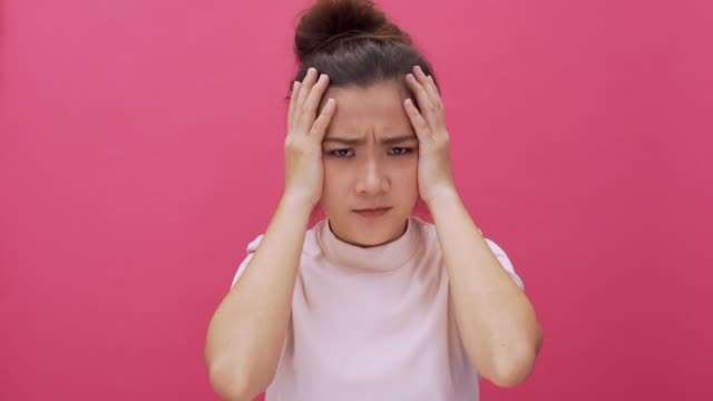 Worry woman on isolated pink background 4k Worry woman on isolated pink background 4k disgust stock videos & royalty-free footage
