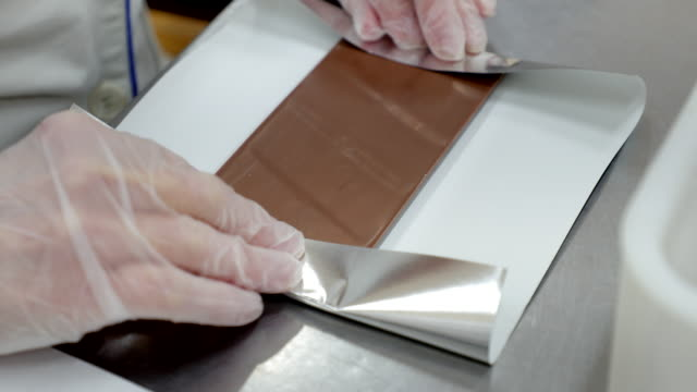 wrapping chocolate in aluminum foil - aluminum foil stock videos & royalty-free footage
