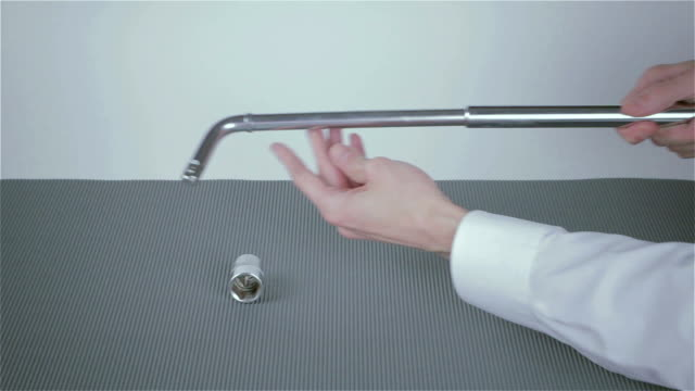 Wrench and screwdriver in hand businessman video