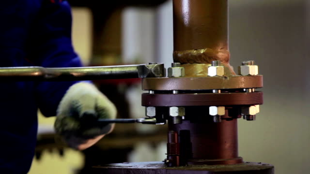 Wrench Tightening Bolt into spurt steel framework video