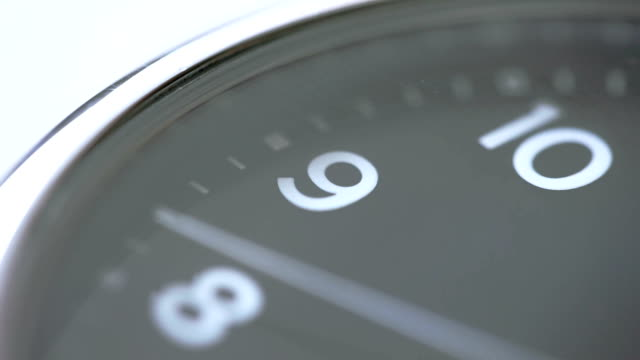 Wristwatch macro Close-up video of a wristwatch speeding through 9 o'clock towards noon. wristwatch stock videos & royalty-free footage