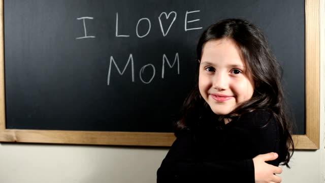 Write 'I Love Mom' on the blackboard video