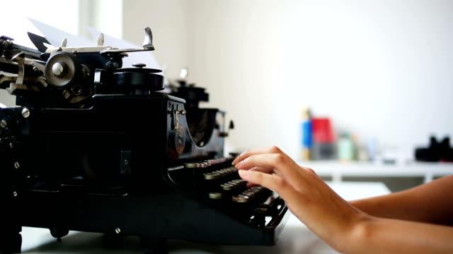 Writer typing with retro typewriter