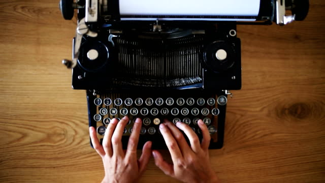 Writer typing with retro typewriter