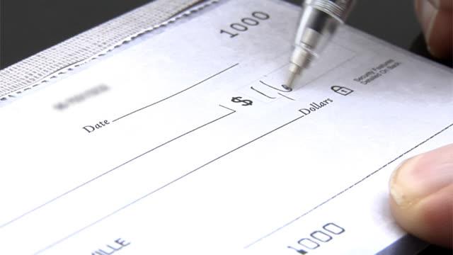 Writing a check, closeup